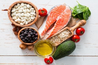 Selection of food that is good for the heart, white wood background